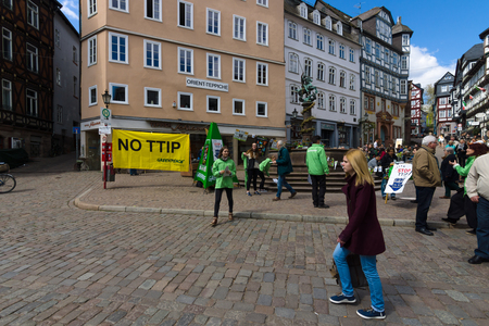 greenpeace: MARBURG, GERMANY - APRIL 18, 2015: Protest Greenpeace activists in the historic center of the city against the Transatlantic Trade and Investment Partnership (TTIP). Editorial