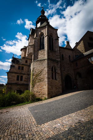 stylization: MARBURG, GERMANY - APRIL 18, 2015: The Marburger Schloss (Marburg castle), is the first residence of Landgraviate of Hesse. Stylization. Toning.