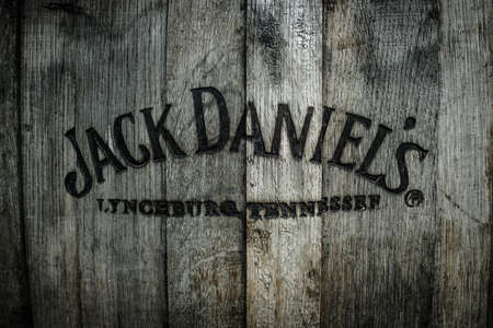 whiskey: BERLIN - MAY 01, 2015: Burned logo of the famous Jack Daniels whiskey at the old wooden barrel. Editorial