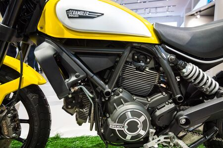 scrambler: BERLIN - MAY 02, 2015: Showroom. Detail of the engine and the fuel tank motorcycle Ducati Scrambler Classic. Produced since 2015.