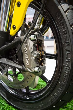 scrambler: BERLIN - MAY 02, 2015: Showroom. Detail of the front wheel and brake system of motorcycle Ducati Scrambler Classic. Produced since 2015.