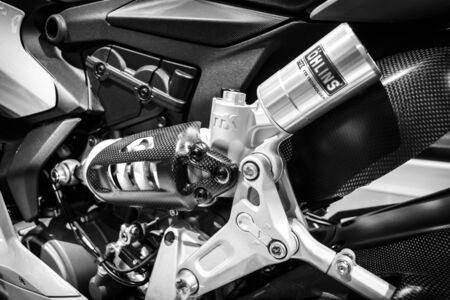 moto gp: BERLIN - MAY 02, 2015: Showroom. Detail of a sport bike Ducati 1299 Panigale by Ducati Corse racing team. Black and white. Produced since 2015.