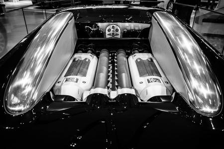BERLIN - MAY 02, 2015: Showroom. Engine of a supercar Bugatti Veyron EB 16.4. Fastest serial car in the world. Rear view. Black and white. Produced from 2005 to 2011