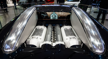 fastest: BERLIN - MAY 02, 2015: Showroom. Engine of a supercar Bugatti Veyron EB 16.4. Fastest serial car in the world. Rear view. Produced from 2005 to 2011 Editorial