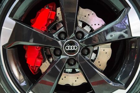 braking: BERLIN - MAY 02, 2015: Showroom. Wheels and braking system components of a hot hatch Audi RS3 (8VA). Produced since 2015. Editorial