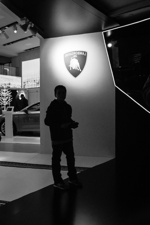 manufacturer: BERLIN - MAY 02, 2015: Showroom. The stand of the manufacturer expensive luxury supercars - Lamborghini. Black and white.