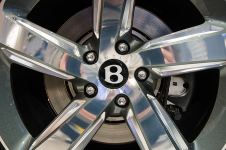 braking: BERLIN - MAY 02, 2015: Showroom. Wheels and braking system components of a full-size luxury car Bentley Mulsanne Speed. Produced since 2014.