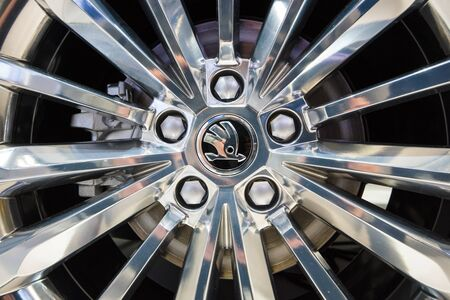 braking: BERLIN - MAY 02, 2015: Showroom. Wheels and braking system of a large family car Skoda Superb (Third generation). Produced since 2015.