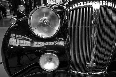 daimler: BERLIN - MAY 10, 2015: Fragment of a luxury car Daimler DE 36 (Straight-Eight Hooper Landaulet), 1949. Black and white. 28th Berlin-Brandenburg Oldtimer Day