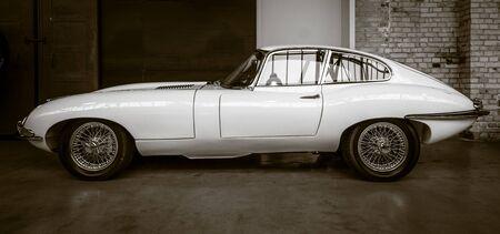 sepia toning: BERLIN - MAY 10, 2015: British sports car Jaguar E-Type (Jaguar XK-E). Vintage toning. Sepia. 28th Berlin-Brandenburg Oldtimer Day