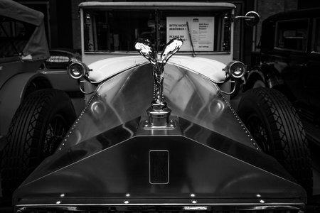 phantom: BERLIN - MAY 10, 2015: The Spirit of Ecstasy is the bonnet ornament on Rolls-Royce Phantom I, 1927. Black and white. 28th Berlin-Brandenburg Oldtimer Day Editorial