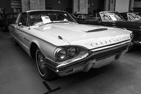 thunderbird: BERLIN - MAY 10, 2015: A large personal luxury car Ford Thunderbird 390 Coupe (second generation), 1964. Black and white. The 28th Berlin-Brandenburg Oldtimer Day
