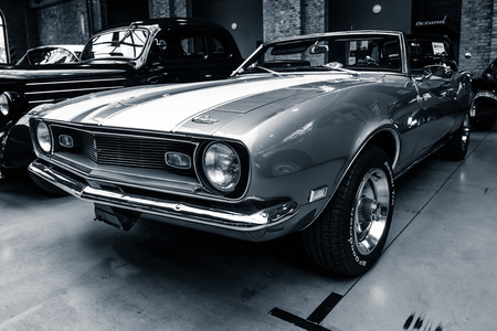 car grill: BERLIN - MAY 10, 2015: Pony car Chevrolet Camaro SS (first generation) convertible, 1968. Stylization. Toning. 28th Berlin-Brandenburg Oldtimer Day