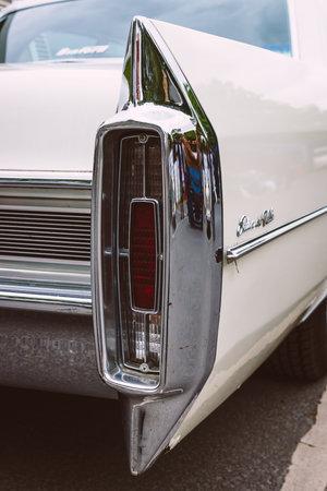 stoplights: BERLIN - MAY 10, 2015: The rear brake lights full-size luxury car Cadillac Sedan De Ville. Stylization. Vintage toning. 28th Berlin-Brandenburg Oldtimer Day Editorial