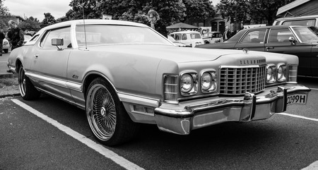 seventh: BERLIN - MAY 10, 2015: Personal luxury car Ford Thunderbird (seventh generation), 1977. Black and white. The 28th Berlin-Brandenburg Oldtimer Day