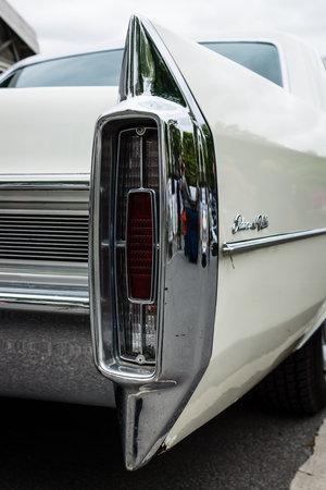 stoplights: BERLIN - MAY 10, 2015: The rear brake lights full-size luxury car Cadillac Sedan De Ville. 28th Berlin-Brandenburg Oldtimer Day
