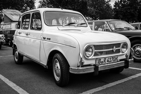 black economy: BERLIN - MAY 10, 2015: Economy car Renault 4. Black and white. The 28th Berlin-Brandenburg Oldtimer Day Editorial