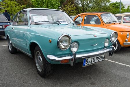 BERLIN - MAY 10, 2015: Vintage car Fiat 850 coupe, 1970. The 28th Berlin-Brandenburg Oldtimer Day Sajtókép