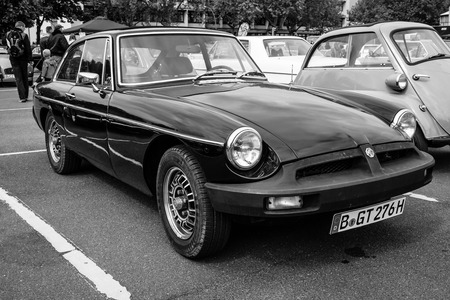 gt: BERLIN - MAY 10, 2015: Sports car MGB GT V8, body designed by Pininfarina. Black and white. 28th Berlin-Brandenburg Oldtimer Day