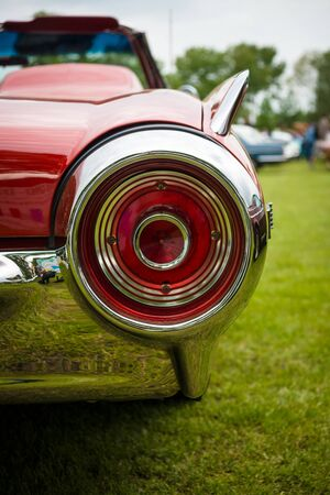 the stoplight: PAAREN IM GLIEN, GERMANY - MAY 23, 2015: Stoplight of a personal luxury car Ford Thunderbird (third generation). The oldtimer show in MAFZ.