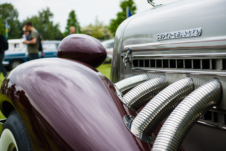 speedster: PAAREN IM GLIEN, GERMANY - MAY 23, 2015: Fragment of vintage car Auburn 852 Speedster. The oldtimer show in MAFZ. Editorial