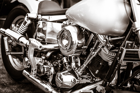 stylization: PAAREN IM GLIEN, GERMANY - MAY 23, 2015: Fragment of a motorcycle Harley-Davidson close-up. Stylization. Toning. The oldtimer show in MAFZ. Editorial
