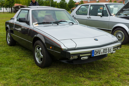 twoseater: PAAREN IM GLIEN, GERMANY - MAY 23, 2015: Sports car Bertone X19 (Fiat X19), 1984. The oldtimer show in MAFZ.