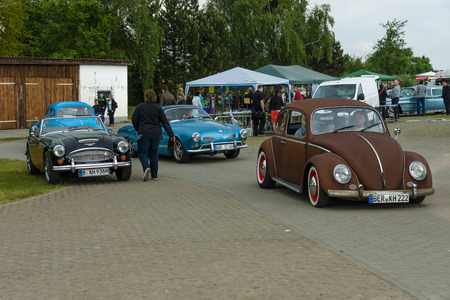 vw: PAAREN IM GLIEN, GERMANY - MAY 23, 2015: Vintage cars VW Beetle, VW Karmann Ghia and Austin Healey 3000. The oldtimer show in MAFZ.