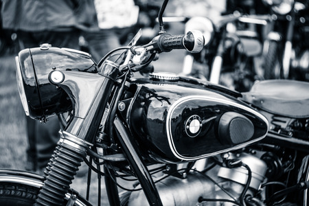 PAAREN IM GLIEN, GERMANY - MAY 23, 2015: Detail of motorcycle BMW R51  3, 1955. Stylization. Toning. The oldtimer show in MAFZ. Editorial