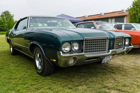 cutlass: PAAREN IM GLIEN, GERMANY - MAY 23, 2015: Mid-size car Oldsmobile Cutlass Supreme, 1972. The oldtimer show in MAFZ.