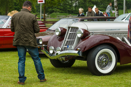 supercharged: PAAREN IM GLIEN, GERMANY - MAY 23, 2015: A man looks at vintage car Auburn 852 Speedster. The oldtimer show in MAFZ.