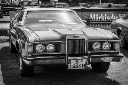 old mercury: PAAREN IM GLIEN, GERMANY - MAY 23, 2015: Personal luxury car Mercury Cougar XR-7. Black and white. The oldtimer show in MAFZ. Editorial