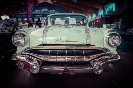 chieftain: PAAREN IM GLIEN, GERMANY - MAY 23, 2015: Full-size car Pontiac Chieftain, 1956. Stylization. Vintage toning. The oldtimer show in MAFZ.