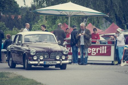 stylization: PAAREN IM GLIEN, GERMANY - MAY 23, 2015: Executive car Volvo Amazon. Stylization. Vintage toning. The oldtimer show in MAFZ.
