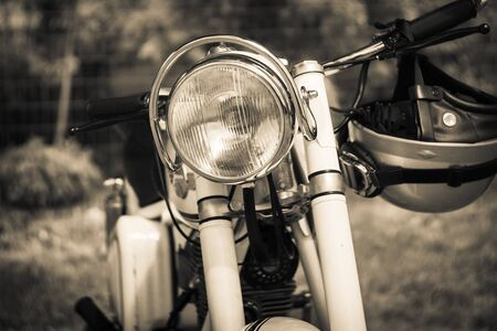 sepia toning: PAAREN IM GLIEN, GERMANY - MAY 23, 2015: Detail of motorcycle Simson Suhl AWO 425. Stylization. Vintage toning. The oldtimer show in MAFZ. Editorial