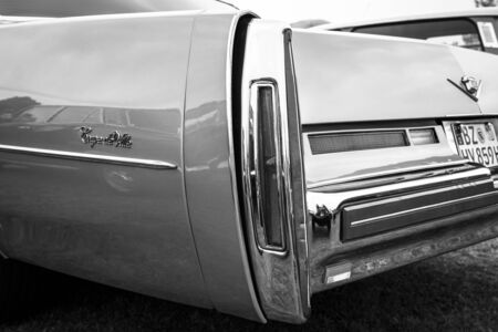 ville: PAAREN IM GLIEN, GERMANY - MAY 23, 2015: Fragment of a full-size luxury car Cadillac Coupe de Ville. Black and white. The oldtimer show in MAFZ.
