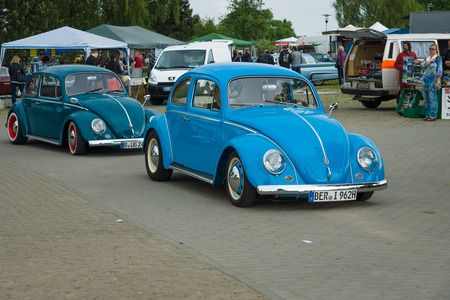 vw: PAAREN IM GLIEN, GERMANY - MAY 23, 2015: Vintage cars VW Beetle on the road. The oldtimer show in MAFZ. Editorial