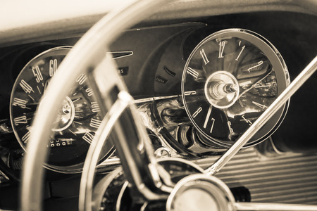 thunderbird: PAAREN IM GLIEN, GERMANY - MAY 23, 2015: The dashboard of a personal luxury car Ford Thunderbird (third generation). Vintage toning. Stylization. The oldtimer show in MAFZ. Editorial