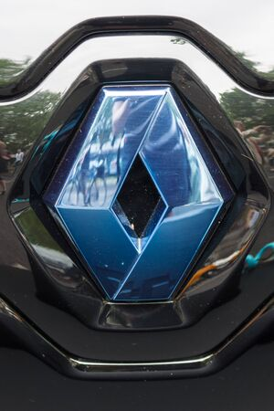 ze: BERLIN - JUNE 14, 2015: Emblem of a two-passenger electric vehicle Renault Twizy Z.E. The Classic Days on Kurfuerstendamm.