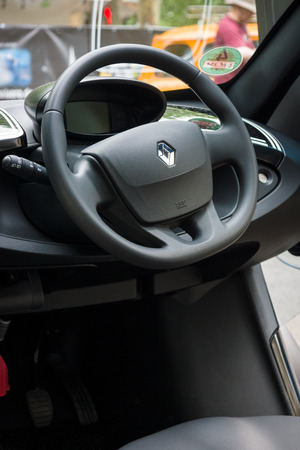 ze: BERLIN - JUNE 14, 2015: Cab of a two-passenger electric vehicle Renault Twizy Z.E. The Classic Days on Kurfuerstendamm.