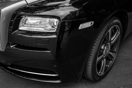 wraith: BERLIN - JUNE 14, 2015: Fragment of the full-size luxury car Rolls-Royce Wraith (since 2013). Black and white. The Classic Days on Kurfuerstendamm. Editorial