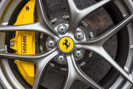 ferrari: BERLIN - JUNE 14, 2015: Wheel and brake system of sports car Ferrari F12berlinetta. The Classic Days on Kurfuerstendamm.