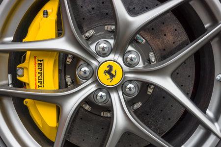 BERLIN - JUNE 14, 2015: Wheel and brake system of sports car Ferrari F12berlinetta. The Classic Days on Kurfuerstendamm.