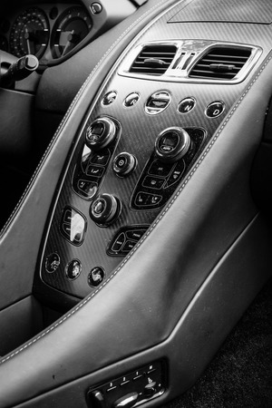 vanquish: BERLIN - JUNE 14, 2015: Cabin of a luxury car Aston Martin Vanquish (since 2012). Black and White. The Classic Days on Kurfuerstendamm.