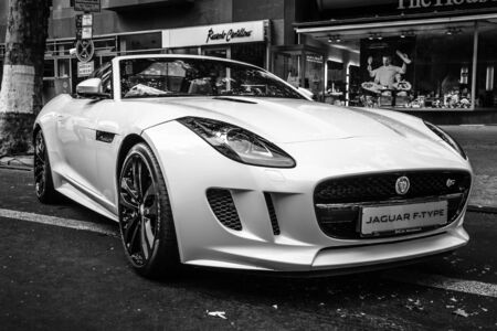 jaguar: BERLIN - JUNE 14, 2015: Sports car Jaguar F-Type V8S Convertible (since 2013). Black and white. The Classic Days on Kurfuerstendamm.