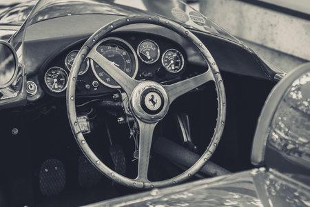 tr: BERLIN - JUNE 14, 2015: Cockpit of a sports car Ferrari 500 TR, 1956. Black and white. Stylization. The Classic Days on Kurfuerstendamm.