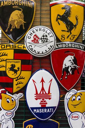 lamborghini: BERLIN - JUNE 14, 2015: Background of various emblems of various car brands producing sports cars. The Classic Days on Kurfuerstendamm. Editorial
