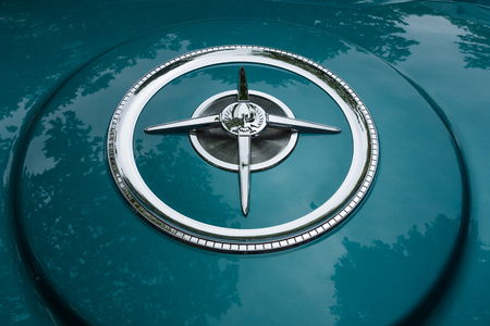 custom car: BERLIN - JUNE 14, 2015: Fragment of a luxury car Imperial Custom 4-door Southampton, 1961. The Classic Days on Kurfuerstendamm.
