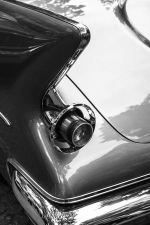 the stoplight: BERLIN - JUNE 14, 2015: Stoplight of a luxury car Imperial Custom 4-door Southampton, 1961. Black and white. The Classic Days on Kurfuerstendamm. Editorial