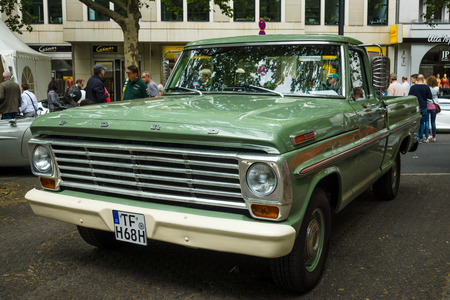 fifth: BERLIN - JUNE 14, 2015: Full-size pickup truck Ford F100 (fifth generation), 1968. The Classic Days on Kurfuerstendamm.